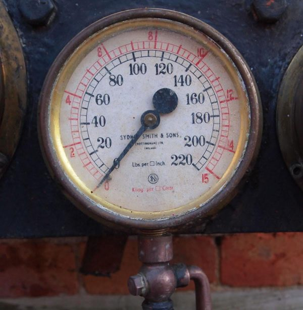 Vintage brass industrial gauge.