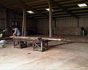 Dean checking a joist before cutting into re-sawn