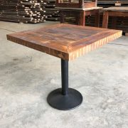Reclaimed timber table metal base