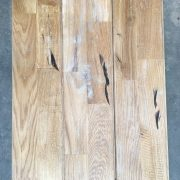 Reclaimed oak strip gym floor (rear of boards)