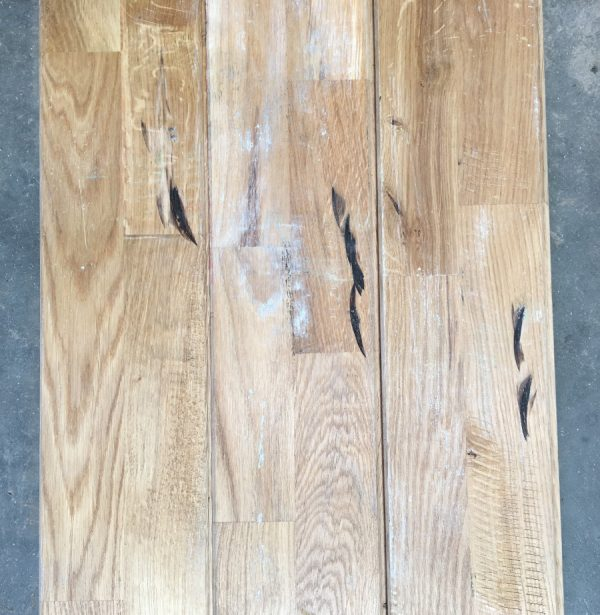 Reclaimed oak strip gym floor (rear of boards)